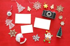 Top view image of christmas festive decorations next to old camera and empty photo frames. For photography and scrapbook montage Stock Image