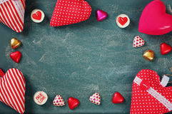 Top view image of colorful heart shape chocolates, fabric hearts on blackboard background. valentine's day celebration concept Stock Photography