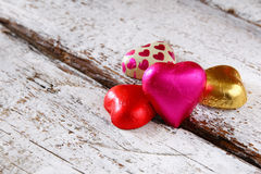 Top view image of colorful heart shape chocolates on wooden table. valentine's day celebration concept. selective focus Royalty Free Stock Images