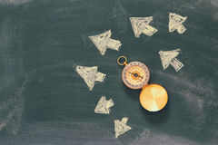Top view image of compass over chalkboard and arrows Royalty Free Stock Photo