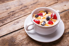 Top view image of corn flakes breakfast background. Top view image of corn flakes with raspberry and mulberry breakfast background Stock Images