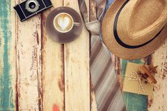 Top view Image of cup of coffee, tie and male fedora hat. Father`s day concept. Top view Image of cup of coffee, tie and male fedora hat. Father`s day concept Stock Image