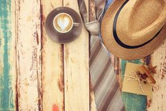 Top view Image of cup of coffee, tie and male fedora hat. Father. `s day concept Stock Photography