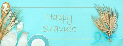 Top view image of dairy products over mint wooden background. Symbols of jewish holiday - Shavuot. Royalty Free Stock Photo
