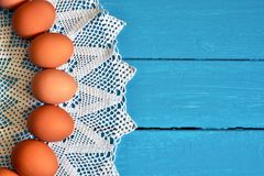 Farm Fresh Organic Eggs. A top view image of farm fresh organic eggs on a bright blue background stock images