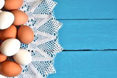 Farm Fresh Organic Eggs. A top view image of farm fresh organic eggs on a bright blue background royalty free stock photography