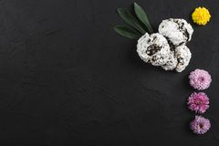 Top view image of flowers and biscuits on rustic stone table. Space for text, closeup.  royalty free stock images