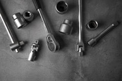 A top view image of hand tools. Set of tools on concrete panel b Royalty Free Stock Photos