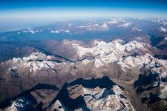 The Himalaya mountain and blue sky horizon from airplane window. Top view image of the Himalaya mountain and blue sky horizon Stock Images