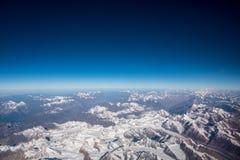 The Himalaya mountain and blue sky horizon from airplane window. Top view image of the Himalaya mountain and blue sky horizon Stock Image