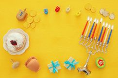 Top view image of jewish holiday Hanukkah background with traditional spinnig top, menorah & x28;traditional candelabra& x29;. Top view image of jewish Stock Images
