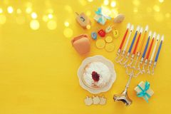Top view image of jewish holiday Hanukkah background with traditional spinnig top, menorah & x28;traditional candelabra& x29; Royalty Free Stock Photo