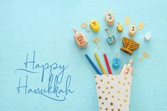 Top view image of jewish holiday Hanukkah background with traditional spinnig top, menorah. (traditional candelabra) and candles stock image