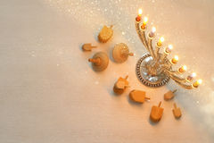 Top view Image of jewish holiday Hanukkah. With menorah (traditional Candelabra) and wooden dreidel (spinning top). Selective focus royalty free stock images