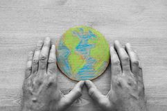 Top view image of man hand holding earth globe Stock Photography