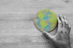 Top view image of man hand holding earth globe Stock Photo