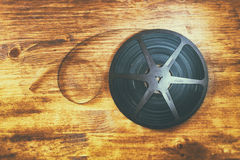 Top view image of old 8 mm movie reel over wooden background Stock Photo