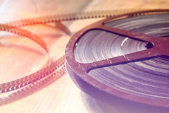 Top view image of old 8 mm movie reel over wooden background Royalty Free Stock Photos