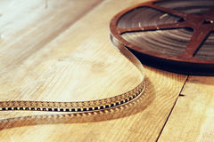Top view image of old 8 mm movie reel over wooden background Royalty Free Stock Images