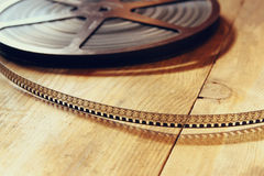 Top view image of old 8 mm movie reel over wooden background Royalty Free Stock Image