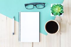 Top view image of open notebook with blank pages and coffee cup on wooden background, ready for adding or mock up Stock Photography