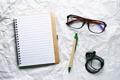 Top view image of open notebook with blank pages with pen on white vintage background Stock Images