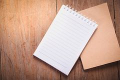 Top view image of open notebook with blank pages on wooden table. royalty free stock photos