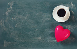 Top view image of pink heart and cup of coffee on blackboard background. valentine's day celebration concept Stock Photography
