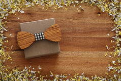 Top view image of preset box and wooden bow tie. Father& x27;s day concept Stock Photography