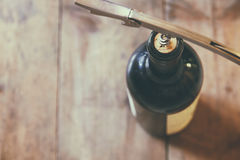 Top view image of red wine bottle and corkscrew Stock Photography
