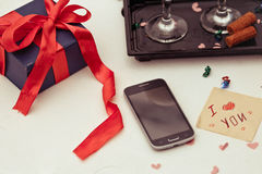 Top view image of smartphone,with a gift box and the card with a Stock Images