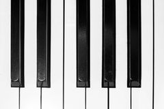 Top view of some piano tiles. This is an top-view image of some piano tiles on a wooden antique old piano Stock Image