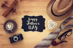 Top view Image of tie and male fedora hat. Father`s day concept. Top view Image of tie and male fedora hat. Father`s day concept Royalty Free Stock Image