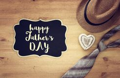 Top view Image of tie and male fedora hat. Father`s day concept. Top view Image of tie and male fedora hat. Father`s day concept Royalty Free Stock Photography