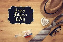 Top view Image of tie and male fedora hat. Father`s day concept. Top view Image of tie and male fedora hat. Father`s day concept Royalty Free Stock Images