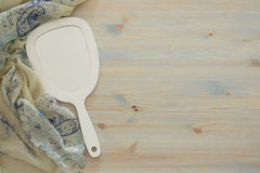 Top view image of vintage hand mirror and delicate female romantic scarf.  Stock Photos