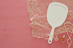 Top view image of vintage hand mirror and delicate female romantic scarf.  Royalty Free Stock Images