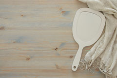 Top view image of vintage hand mirror and delicate female romantic scarf.  Stock Image