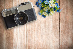 Top view image of vintage old camera on wooden table background Stock Image