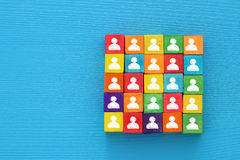 Top view image of a wood blocks with people icons , human resources and management concept. Stock Image