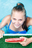 Top view image of young beautiful girl in pool Royalty Free Stock Images