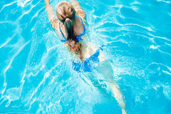 Top view image of young girl swimming in pool Royalty Free Stock Image