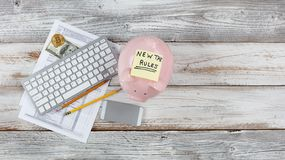 Top view of income tax forms with new changes plus piggy bank on white rustic desk royalty free stock photography