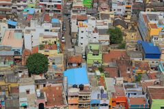 Top view of the Indian. Town. Roofs of houses, urban buildings, houses and cars in a small Indian city. Tiruchchirapalli from a bird`s eye view Royalty Free Stock Images