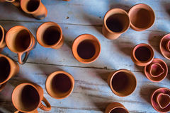 Top view of indian traditional handmade pottery of different sized cups, lamps, and jugs, Chennai, India, Feb 25 2017 Royalty Free Stock Image