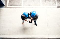 A top view of an industrial man and woman engineer with tablet in a factory, working. royalty free stock photo