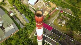 Top view of industrial pipe with old production buildings. Action. Old suburban industrial area with factories and plant stock video