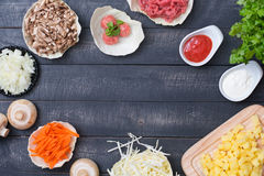 Top view of Ingredients for cooking soup with meatballs with a p. Сabbage, mushrooms, potatoes, onions, beef, herbs as ingredients for cooking soup with Stock Images