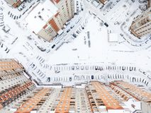 Top view at the inner yard with lot of parked cars at winter season. Vew from residential building roof. St. Petersburg, Russia. Stock Images