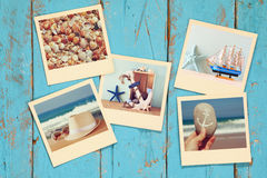 Top view of instant photos album on wooden background royalty free stock image